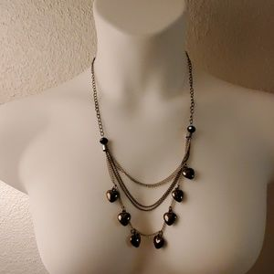 Layered gunmetal earing and heart necklace set